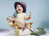 1960s Baby Boy Sitting Booster Chair Holding Cigar Wearing Hat Holding Telephone Photographic Print