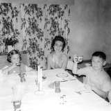 Mother with Children at the Dinner Table, Ca. 1962 Photographic Print