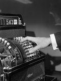 1930s-1940s Man's Hand Pushing Price Buttons on Cash Register Photographie