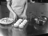 1940s-1950s Woman Preparing Dinner Baking Rolls and Pie Photographic Print