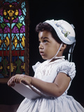 1960s Religious Little African American Girl Wearing White Hat and Dress Holding Bible Standing Fotografisk tryk