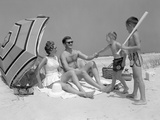 1960s at the Beach Two Boys with Baseball Bat Trying to Pull Up Father So He Will Play with Them Photographic Print