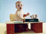 1960s Baby Businessman Sitting at Toy Desk Loans Sign Wearing Eyeglasses Photographic Print