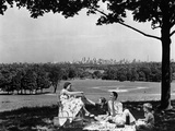 1930s-1940s Family Picnicking under a Tree in Fairmont Park with Skyline of Philadelphia Photographic Print