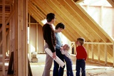 1980s Family of Four Inspecting New Home under Construction Photographic Print