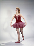 1960s Awkward Teenage Girl Dancer in Red Velvet Tutu Costume and Toe Shoes Photographic Print