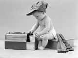 1940s Baby in Railroad Engineer Hat Pulling Milk Bottle from Lunch Pail Photographic Print