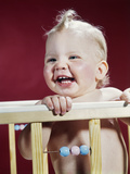 1960s Laughing Blond Baby in Crib or Playpen Photographic Print