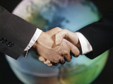 1960s Male Handshake in Front of World Globe Photographic Print