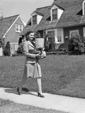 1940s Woman Walking Shopping Carrying Grocery Bag on Suburban House Sidewalk Photographic Print by H. Armstrong Roberts
