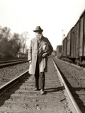 1930s Great Depression Era Man Homeless Hobo Walking Down Railroad Tracks Photographic Print by H. Armstrong Roberts
