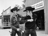1950s-1960s Cowboy Sheriff Marshall Nabs Arrest Gunfighter Outlaw Near Livery Stable Photographic Print by D. Corson