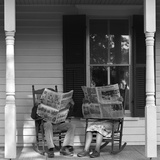 Couple Man Woman Sitting on Porch in Rocking Chairs Holding Newspapers Up Hiding their Faces Photographic Print by D. Corson