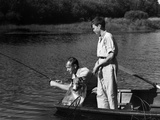 1930s Man Father Teenage Boy Son Dog in Row Boat Fishing in Pond Photographic Print by H. Armstrong Roberts