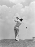 1930s Man Playing Golf Teeing-Off Golf Ball from Tee with Driver Outdoor Photographic Print by H. Armstrong Roberts