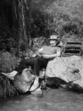 1950s Lazy Fisherman Lying Back on Rock with Hat Pulled over Eyes Fishing in Creek Photographic Print by H. Armstrong Roberts
