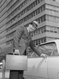 Businessman Carrying Briefcase Getting into Car on Urban Street Photographic Print by H. Armstrong Roberts