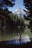 Man Fishing at String Lake Grand Teton National Park Wyoming Photographie par D. Corson