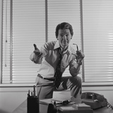 Businessman Standing Behind Desk Arm Raised in Pleading Gesture Photographic Print by H. Armstrong Roberts