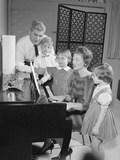 Family Standing around Piano Singing Photographic Print by H. Armstrong Roberts