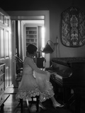 1920s Woman Pianist Sitting Playing Piano Photographic Print by H. Armstrong Roberts