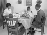 African-American Family at Dining Table with Turkey Saying Grace Praying Photographic Print by H. Armstrong Roberts