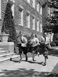 1940s Three School Children 2 Boys 1 Girl Running Down Sidewalk Carrying Books Photographic Print by H. Armstrong Roberts