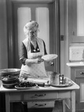 1920s-1930s Senior Woman Grandmother Wearing Apron Crimping Crust Making a Cherry Pie in Kitchen Photographic Print by H. Armstrong Roberts