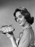 1950s-1960s Smiling Woman Holding Freshly Baked Pie Photographic Print by H. Armstrong Roberts