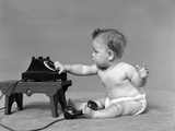Baby in Diaper Dialing Telephone Photographic Print by H. Armstrong Roberts