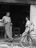 1930s Man Father Holding Hand Tools Talking to Boy Son Leaning in Doorway of Boat Shed Photographic Print by H. Armstrong Roberts