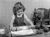 1950s Little Girl Rolling Out Apple Pie Crust on Kitchen Table with Cocker Spaniel Puppy Watching Photographic Print by H. Armstrong Roberts