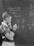 Boy at Blackboard Doing Math Multiplication Problem Photographic Print by H. Armstrong Roberts