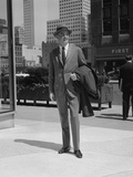 Businessman Wearing Suit Hat Carrying Top Coat Standing on City Street Photographic Print by H. Armstrong Roberts