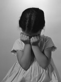 1960s Sad Little Girl Sitting Hands on Face Crying Photographic Print by H. Armstrong Roberts