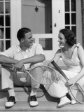 1930s Couple in Tennis Whites Holding Racquets Sitting Talking on Steps in Front of House Outdoor Fotografiskt tryck av H. Armstrong Roberts
