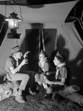 3 Boy Scouts Sitting Tent Night Telling Ghost Stories Photographie par D. Corson