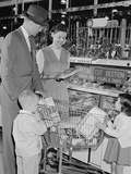 Family of 4 Inside Supermarket Father Pushing Cart Mother 2 Kids Photographic Print by H. Armstrong Roberts