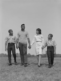 African-American Family Holding Hands Walking in Grassy Field Photographic Print by H. Armstrong Roberts