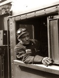 1920s-1940s Railroad Train Engineer Looking Out Window of Locomotive Cab Driving the Steam Engine Photographic Print by H. Armstrong Roberts
