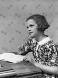 1930s Teenage Girl Thinking Sitting at Table Doing Homework Photographic Print by H. Armstrong Roberts