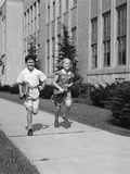 Boy Girl Running Down Sidewalk Carrying School Books Smiling Photographic Print by H. Armstrong Roberts