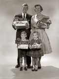 1940s-1950s Family Carrying Christmas Gifts Wrapped Presents Photographic Print by H. Armstrong Roberts