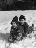 1930s Boy and Girl Laughing Sledding in Snow Photographic Print by H. Armstrong Roberts