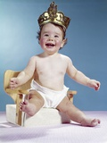 1960s Smiling Happy Baby Wearing Crown Sitting on Booster Seat Chair Throne Photographic Print by H. Armstrong Roberts