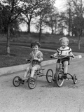 1930s Two Boys Riding Tricycles Fotoprint van H. Armstrong Roberts