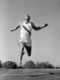1960s Man Running Winning Sprinting across the Finish Line Outdoor Photographic Print by H. Armstrong Roberts
