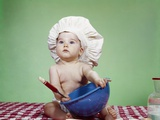1960s Serious Baby in Chef Hat with Mixing Bowl and Spoon Photographic Print by H. Armstrong Roberts