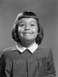 1950s Girl Page Boy Hair Bangs Smiling Funny Facial Expression Photographic Print by H. Armstrong Roberts