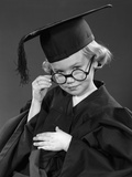 1950s Little Blond Girl Wearing Scholarly Glasses Graduation Cap and Gown Photographic Print by H. Armstrong Roberts